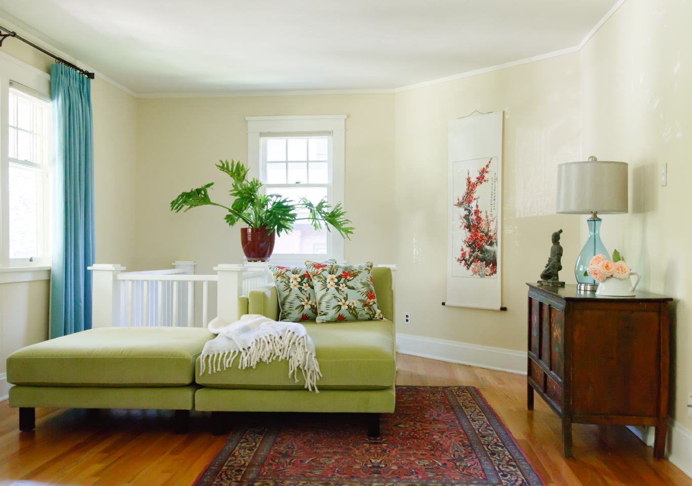 Upstairs nook with green chaise and ottoman