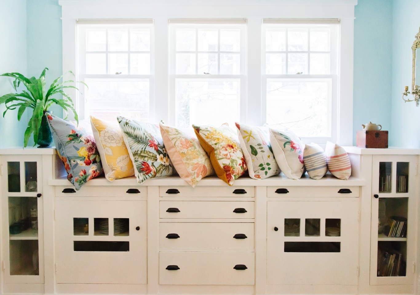 Floral pillows on window banquette