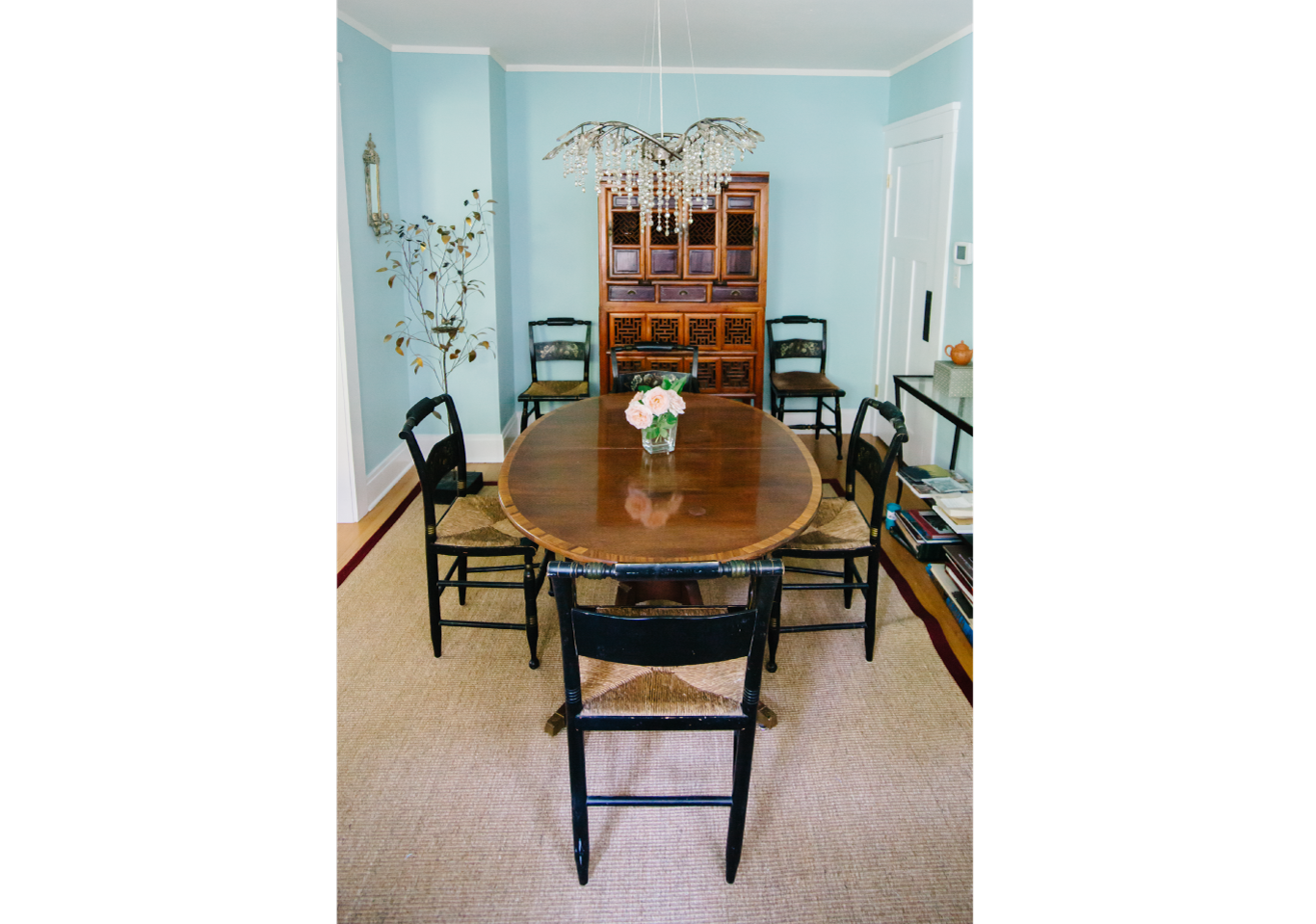 Antique wooden dining room table with black chairs