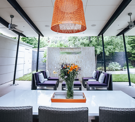 patio sitting area purple chairs and orange chandelier