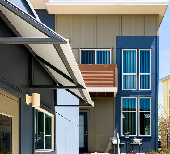 Olive green and blue contemporary townhome exterior