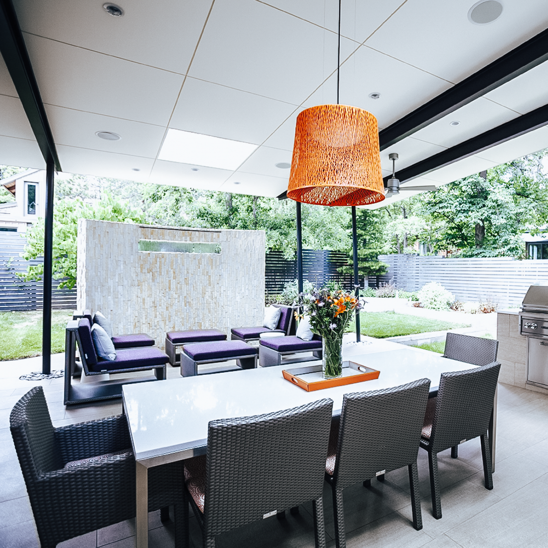 Outdoor patio space with dining and lounging areas