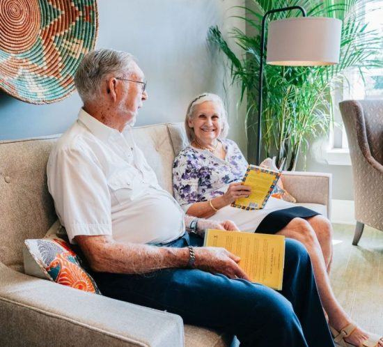 retirement home two people talking in sitting area