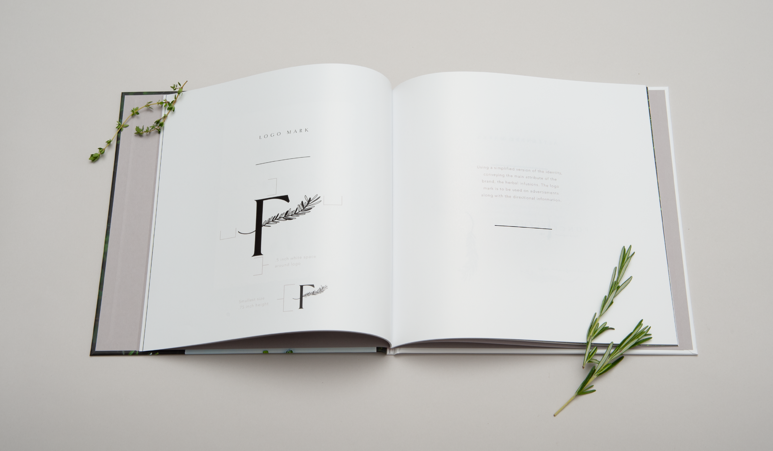 brand guidelines book for herbal cafe with rosemary sprigs